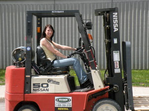 Female driving forklift